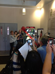 Mayor Spitaleri and Director Rosenblum cut the ribbon on the new Library Lending Machine