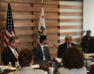 Congressman Mike Honda discusses with HUD Secretary Julian Castro and County Supervisor Board President Dave Cortese the legislative difficulties in supporting homeless housing efforts, while one of Onizuka Crossing's new homeless veteran residents looks on.